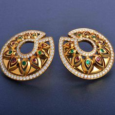 One pair of Cartier multi-gem set 18k rose gold circular earrings, set with vibrant deep red rubies and lively emeralds, outlined by fine quality diamonds. Earrings can be worn post and clip back.