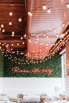 Rosé All Day neon sign at The Hampton Social in Chicago + Bows & Sequins' favorite French rosé wines!