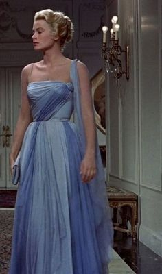 This strapless sky blue gown, complete with sheer sash and a matching clutch, was beyond iconic –– like something straight out of a fairytale.   Grace Kelly in To Catch a Thief, circa 1955. - Illustrious Celeb Fashion From the Year You Were Born - Photos