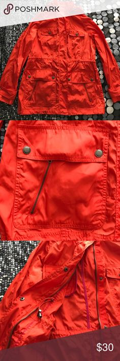 A.N.A. Packable Raincoat Trenchcoat Burnt Orange Like new raincoat trench size Large in burnt orange. Has drawstring waist. Multiple pockets, removable hoodie. Packs into interior pocket. A.N.A. Jackets & Coats Trench Coats