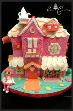 Sweet Creations (FB): Hello Everyone,Hope you all are doing good.Thank you for your lovely comments and messages. Here's another of our creation.Make your kids dream come true.Lalaloopsy house cake !!! This was probably the most challenging cake I've ever made.Check out the Album for all the details.