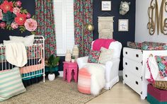 Caden Lane shares a dark floral nursery that is both dramatic and feminine at the same time. The paper flowers above the crib are a complete showstopper.
