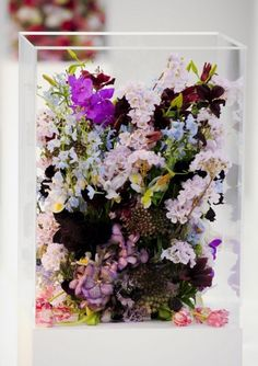 Beautiful flowers in a lucite box, Jil Sander