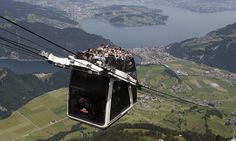 Bagsy the seat in the middle! Swiss unveil double-decker cable car with open-air sundeck (but you'll need a head for heights)