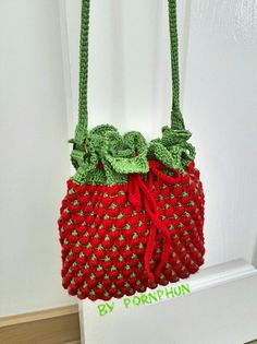 Crochet cross body strawberry bag created by me .