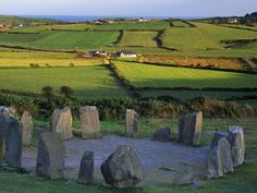 """Drombeg Stone Circle, County Cork, Ireland. Drombeg stone circle (""""The Druid's Altar""""), is a Recumbent stone circle located 1.5 mi east of Glandore, County Cork, Ireland.  Drombeg is one of the most visited megalithic sites in Ireland, protected under the National Monuments Act. The area of the circle has been covered in gravel to protect it from the volume of visitors.The stone circle consists of 17 closely spaced stones spanning 31 ft in diameter, of which 13 survive."""