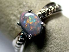 RED COLOUR BLACK OPAL RING 18K WHITE GOLD SIZE 5.5 SCA 726