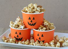 Homemade Caramel Corn Snack Mix from Glorious Treats (she got orange cups from Target and painted on faces - CUTE!)