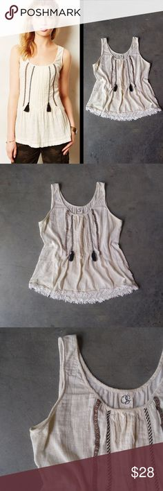 One September Tassel Fringe Tank One September tank from Anthropologie, size large, in pre-loved condition. Tank has wear and discoloration in arm pit and slight discoloration around neckline--however, the base color of the top is a cream/ivory/off-white so it's hard to tell. Pleats down front with black tassels at waist. Cover photo from Anthro website. No trades. No modeling. Make a reasonable offer. Thanks! Anthropologie Tops Tank Tops
