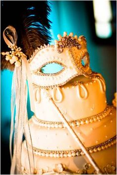 Cake design has become truly inspirational, this edable mask in white chocolate will certainly make a striking addition to your reception. Imaganie this on a small round table in the center of your tables atop a tall gold cake stand. This is not just a cake its a work of art to be viewed.