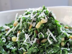 Melt in your Mouth Kale Salad: Ingredients      1 bushel of lacinato or dinosaur kale, stems removed, rinsed and patted dry     ⅓ cup currants (or chopped raisins)     juice of one lemon     1 tbsp of olive oil     1 tsp local honey     ½ cup pine nuts toasted     salt and pepper to taste     4 tbsp grated raw parmesan cheese