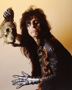 "Alice Cooper, and yes I am a huge fan of his music. I like more than just ""School's Out"", which isn't even a very good song to be quite honest. I like pretty much all of his work especially ""Black JuJu"" which I loved to play the piano riff to on my keyboard when I was 8 years old."