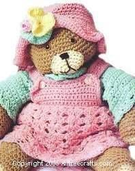 Free crochet pattern to make an adorable teddy bear, with other free patterns available to make the teddy a dress, hat, exercise outfit and other clothes.