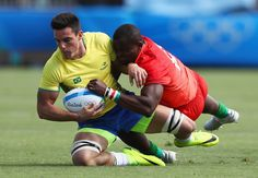 Felipe Sancery of Brazil is tackled by Willie Ambaka of Kenya during the Men's Rugby Sevens placing 11-12 match between Brazil and Kenya on Day 6 of the Rio 2016 Olympics at Deodoro Stadium on August 11, 2016 in Rio de Janeiro, Brazil.