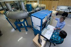 Time travelers: Scientists use radiocarbon dating to analyze everything from the world's oldest shoe to sediment samples that shed light on global climate change. More: http://news.uci.edu/features/time-travelers/   Shown: Inside the W.M. Keck Carbon Cycle Accelerator Mass Spectrometry Laboratory. Photo by Steve Zylius, UC Irvine Communications.