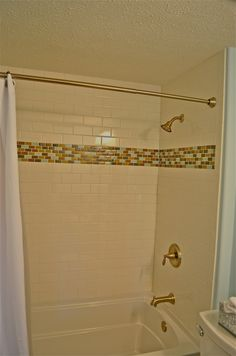 Subway tiled shower with glass border.