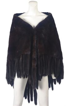 YVES SAINT LAURENT (1936-2008)  AN EVENING WRAP  1980s, ranch mink with tail fringe, sold at Christie's in 2008 for $4980
