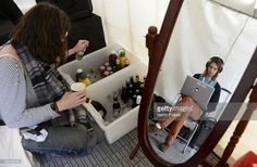 Kevin Parker (in mirror) and Dominic Simper of Tame Impala backstage at the Parklife Music Festival on 6th October 2012, in Melbourne, Australia.
