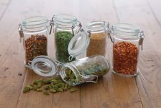 Ideal for storing dried herbs and spices. This oval shaped glass jar keeps content fresh with it's airtight clip. Glass Jars, Clear Glass, Mason Jars, Christmas Jars, Hanging Racks, Jar Gifts, Gift Jars, Spice Jars, Drying Herbs