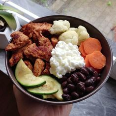 My lunch earlier today food oats(?) with chili chicken,bcauliflower, zucchini,ncarrot, black beans and cottage cheese #Padgram