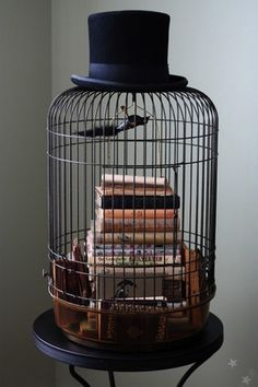 Repurposed Bird Cages In Home Décor. I am so confused by this but it's awesome. Who says décor has to make sense?