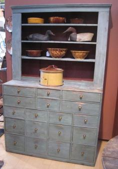 Blue apothecary cupboard from Linda Rosen Antiques - omg!