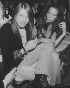 """Rocker Axl Rose sitting closely to super model Stephanie Seymour at Elite 1991 Intl. """"Look of the Year"""" contest at Plaza Hotel, September 1991"""