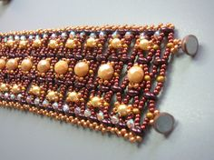 Create an elegant unique beadwork bracelet which contains Swarovski Bicones, seed beads, Superduo beads, Czech pearls and Fire polished beads. This eye touch bracelet was named by me : Earth treasures . (I was thinking about the earth colors and the glitter of its treasures- Earth treasures).  Colors & length may be changed as you wish.  Earth treasures PDF Pattern Tutorial is a great way to use the Superduo or Twin beads with the glitter of the Swarovski bicones, and the embellishment of...