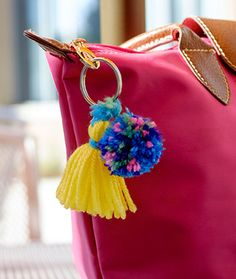 DIY pom pom and tassel keyring -- cute added to a plain bag or just as a DIY keyring. Good project for yarn scraps.