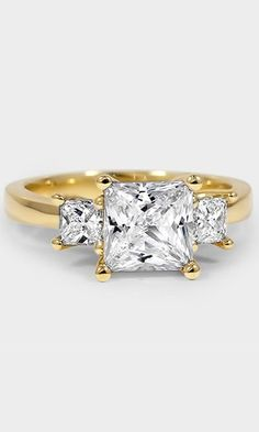 This stunning three stone trellis setting features interwoven prongs sweeping upward to embrace two perfectly matched princess diamond side stones.==