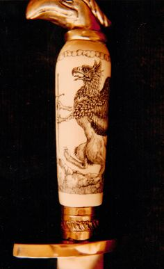 Brass and Ivory hilted knife, with Gryphon, by David St. Albans 1984