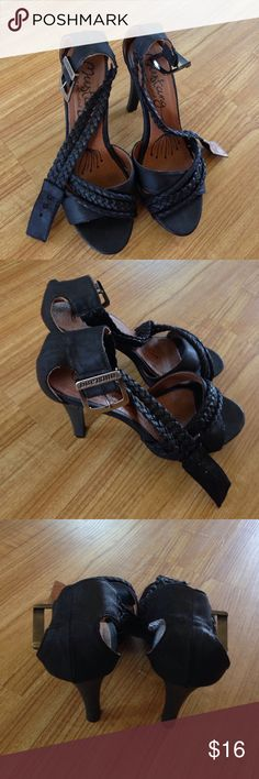 Black sandals In good condition true to size. Heel height 4 1/2 Mustang Shoes Sandals