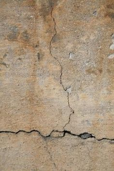 How to Repair a Leaky Basement Wall - hydraulic cement - wire brush - trowel - waterproofing paint - slant dirt away from foundation, gutter outlets feed 5 ft away from foundation