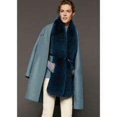 Long fox fur scarf backed in baby cashmere jersey. Subtly shaped to wrap comfortably around the neck, it comes with a tonal plongé leather belt to cinch it in around the waist, creating a vest to wear under a coat or over a sweater. A versatile, exclusive accessory for the winter season.