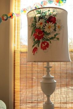 can you believe this was an ugly cheap old brass lamp!?!?  coat of paint + vintage tablecloth = fabulous!!