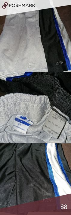 Athletic boys shorts, 2 pairs One pair Champion black, with a gray and blue stripe. One pair Starter gray shorts. Both size S (6-7). Champion & Starter Bottoms Shorts