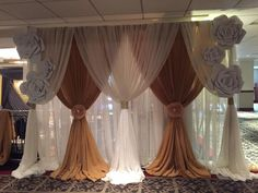 wedding backdrop pvc pipe frame then just throw the first dark drapes over pipe, tie, then throw three white drapes over the top and tie only the front section of each. The ends cover the frame. Love the hand made extra large fabric flowers. DIY