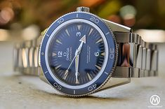 The @omegawatches Seamaster 300 Master Co-Axial (titanium edition with blue dial shown) - this truly inspired watch with vintage design, is a modern diving watch, offering the best in required features: hours, minutes and seconds for the indications (no date window pollutes the dial), 300-meter water-resistance, screw-down crown, unidirectional rotating bezel, and bracelet with easy fine adjustment. #omega #watchtime #divewatch