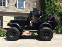 Black 1980 CJ5 with Big Tires