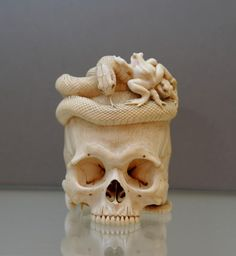 Japanese Ivory skull, snake & frog  c. 1880   Tokyo School, unsigned, in the style of Asahi Gyokuzan, Meiji Period