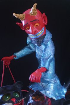 huge paper mache devil on cat