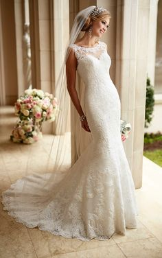 Stella York #6125 - Fit and flare lace gown with lace illusion neckline and low v back.