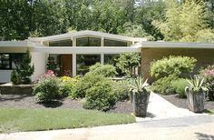 Mid-Century modern house: 1959 brick ranch with voluminous glass windows. Atlanta