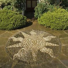 "A cheery sun mosaic set close to an entryway is a great way to say ""welcome to our home."""