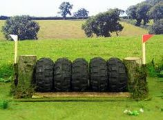 Bad ass tire jump: Will be asking dad to save all his used up tractor trailer tires: very cool!