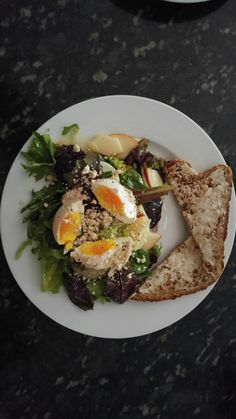 Sunday brunch! Organic greens, red onions, fennel & organic pears thinly sliced + Home made dressing with lemon juice, EVOO, salt, red chilly flakes & honey + poached organic eggs with multigrain & seed bread toasted with some organic sweet butter.