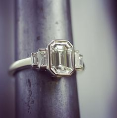 Art-Deco emerald cut diamond engagement ring. 1.54 carat Emerald #VintageRings #AntiqueRings #VintageDiamonds