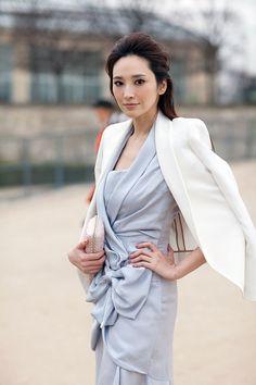 white blazer with a pastel dress