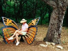 Woman sitting in a butterfly chair at botanical gardens Zilker Park, Austin, TX. Photographer Richard Cummins (no idea who the artist who created the butterfly chair was) Butterfly Chair, Monarch Butterfly, Butterfly Park, Unique Furniture, Garden Furniture, Porch Furniture, Furniture Dolly, Inexpensive Furniture, Furniture Ideas