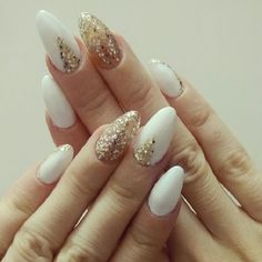 White and Gold Glittery Nail Art Design. Go bold and elegant with your nails using gold glitter on white base. Or you can just change the pattern of leaving gold on the nails, just like the way you like.